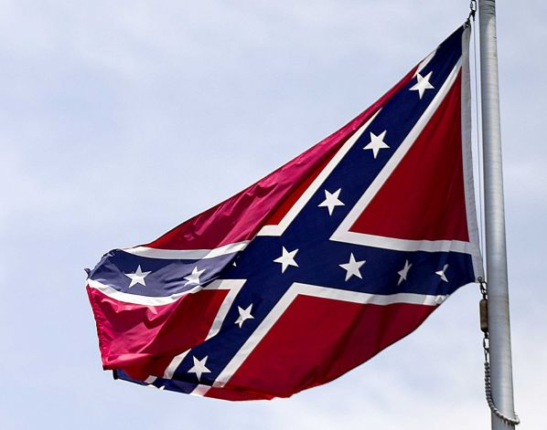 Confederate flag flies at the base of Stone Mountain in Stone Mountain Ga. The House is about to put its members on record on whether Confederate flags can decorate rebel graves in historic federal cemeteries