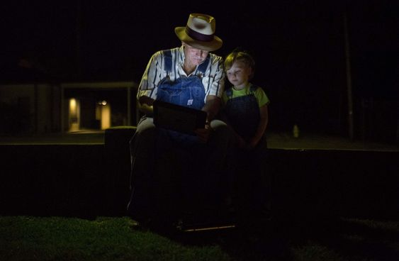 Decatur Ala. sits and waits with his granddaughter Mariah Lyerly 3 of Nashville Tenn. before the midnight book release of'Go Set a Watchman by author Harper Lee Tuesday