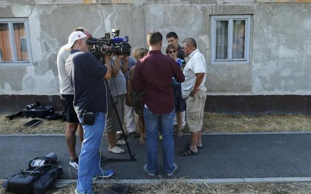 A family friend of Tomislav Salopek speaks to the media in Vrpolje village Croatia