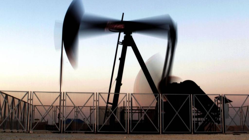 An oil pump at work at sunset