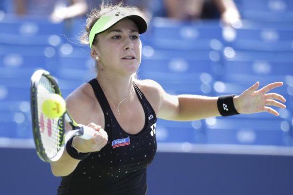 Belinda Bencic of Switzerland returns the ball