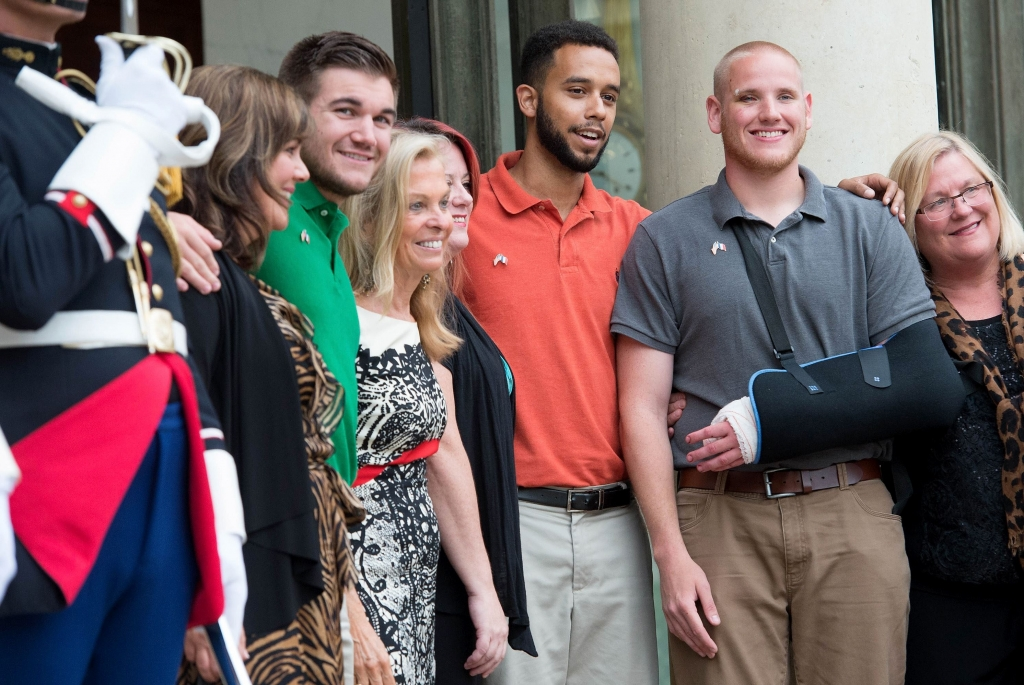 485079504 U.S.-France Ambassador Jane Hartley third from left and honorees attend a reception at Elysee Palace today in Paris where Spencer Stone second from right Anthony Sadler center and Alek Skarlatos second from left were awarded the Legion