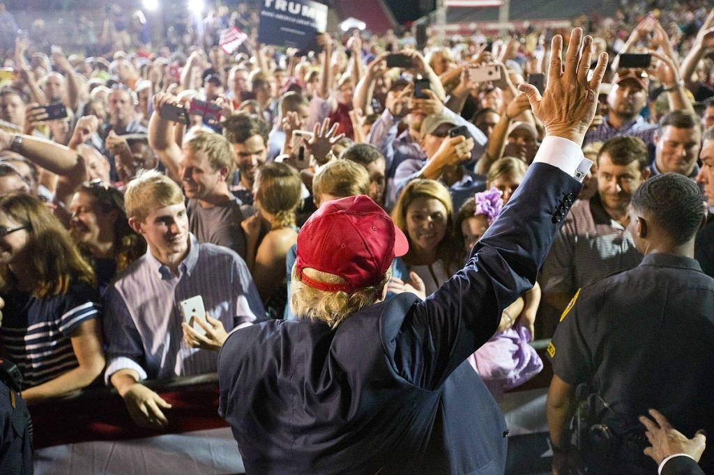 Republican presidential candidate Donald Trump waves to the crowd during a campaign pep rally