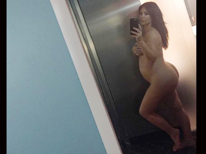 Nude Kim Kardashian flaunts big baby bump