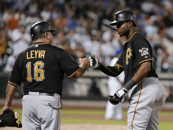 Polanco right celebrates with first base coach Nick Leyva after hitting an RBI single during the 10th inning of a baseball game against the New York Mets on Friday Aug. 14 2015 in New York. (AP