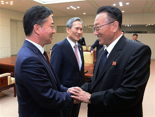 South Korean Unification Ministry South Korean Unification Minister Hong Yong-pyo left shakes hands with Kim Yang Gon right a senior North Korean official responsible for South Korean affairs as South Korean presidentia