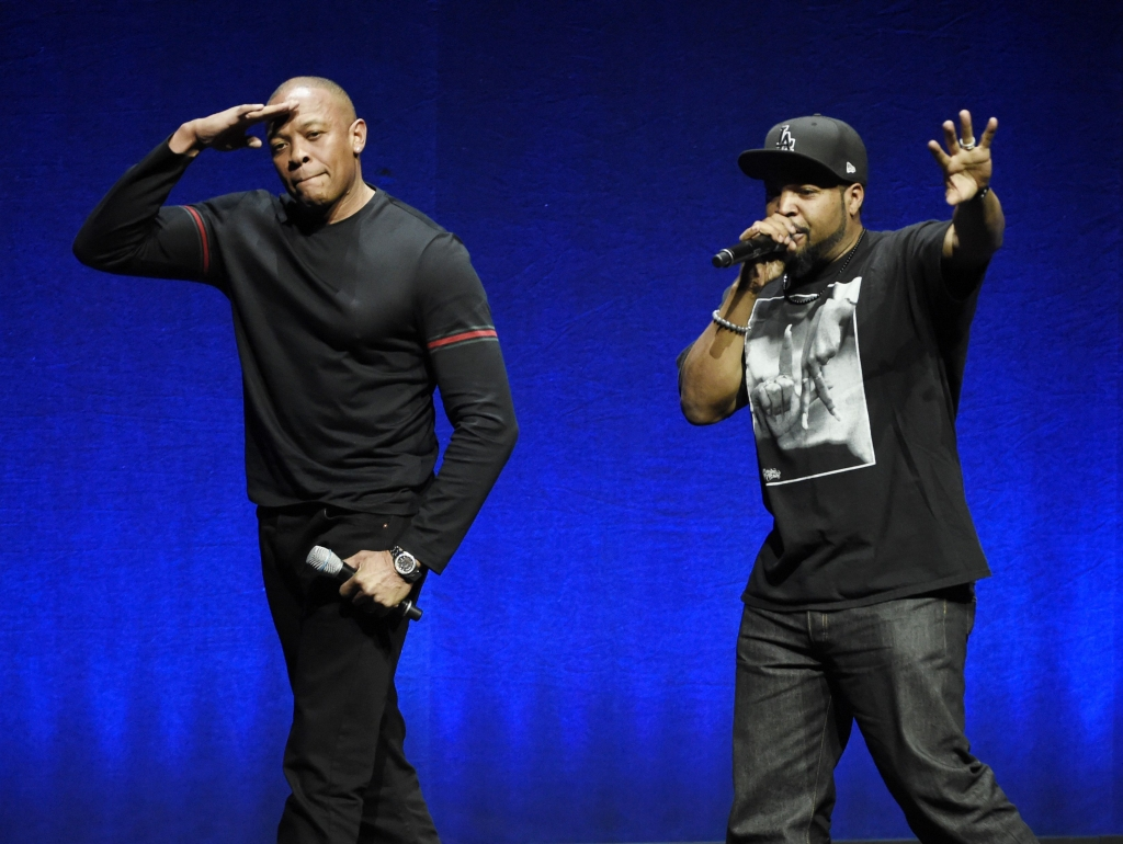 N.W.A. members Dr. Dre left and Ice Cube two of the subjects of the upcoming biographical drama'Straight Outta Compton' salute the crowd after speaking at the Universal