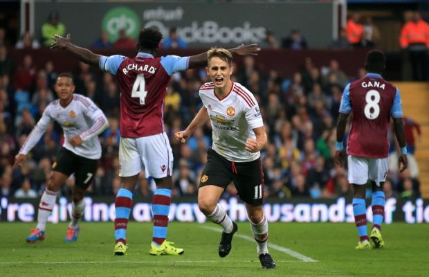 Manchester United's Adnan Januzaj celebrates scoring at Villa Park