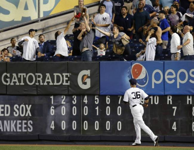 Yankees right fielder Carlos Beltran watches as a spectator catches Blake Swihart's eighth-inning two-run home run