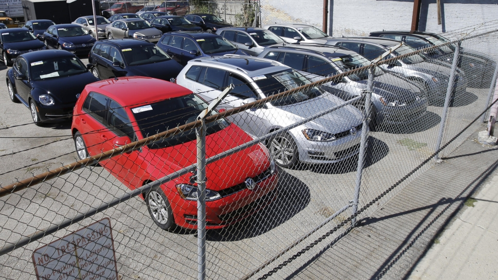 Volkswagen diesels are shown behind a security fence on a storage lot near a VW dealership in Salt Lake City. The carmaker is reeling from a scandal over its use of devices to fool emissions tests of diesel models