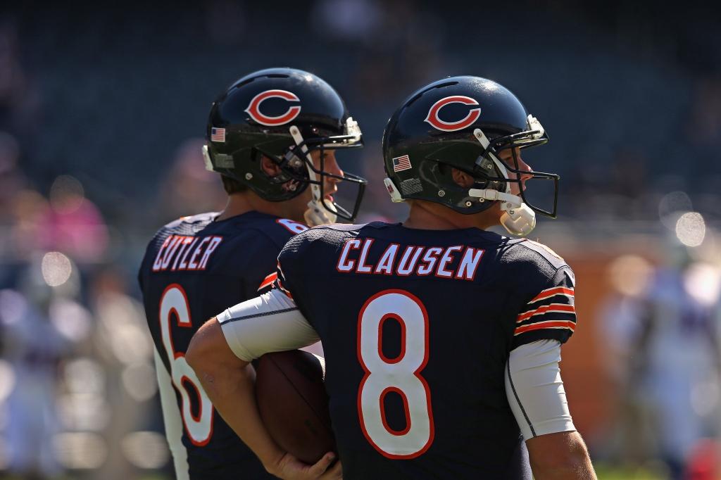 Bears quarterbacks Jay Cutler left and Jimmy Clausen