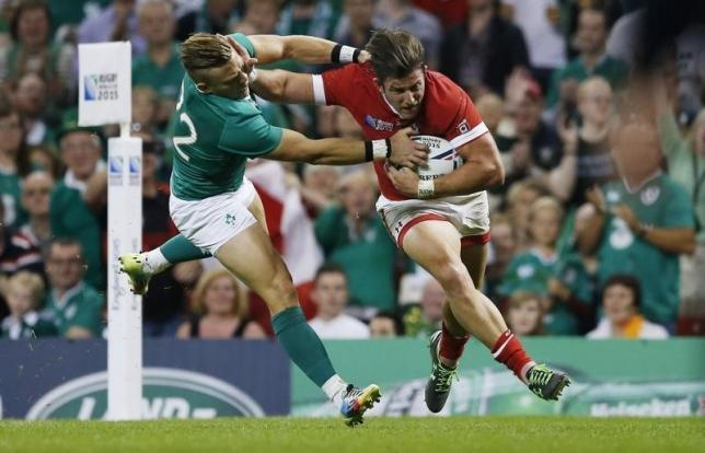 Canada's DTH van der Merwe runs in their first try against Ireland at Cardiff