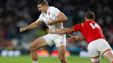 England's Jonny May left is tackled by Wales George North. AP