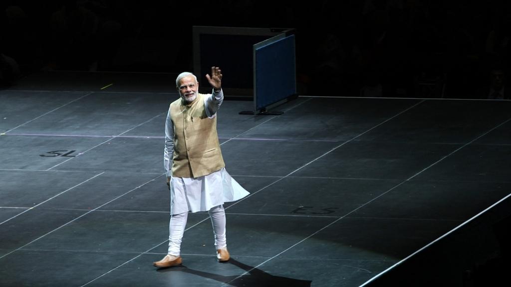 India's Prime Minister Modi walks onto the stage at San Jose's SAP Center