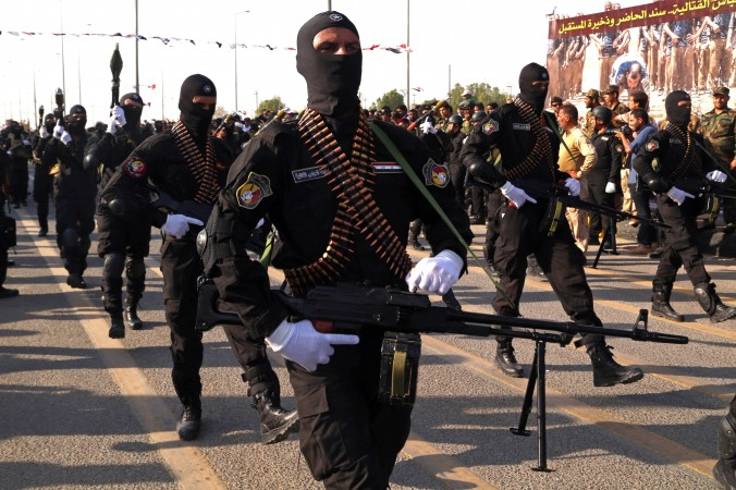 Armed members of the Abbas combat squad a Shiite militia group march in a military parade in Basra 340 miles southeast of Baghdad Iraq Saturday Sept. 26 2015