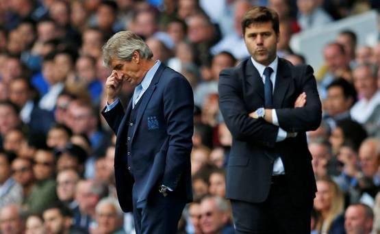 Manchester City manager Manuel Pellegrini looks dejected as Tottenham manager Mauricio Pochettino looks