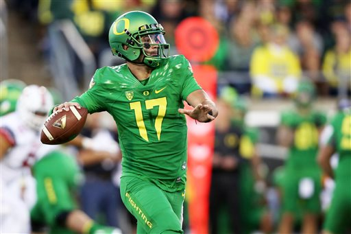 Oregon quarterback Jeff Lockie looks to pass during the first half of an NCAA college football game against Utah Saturday Sept. 26 2015 in Eugene Ore