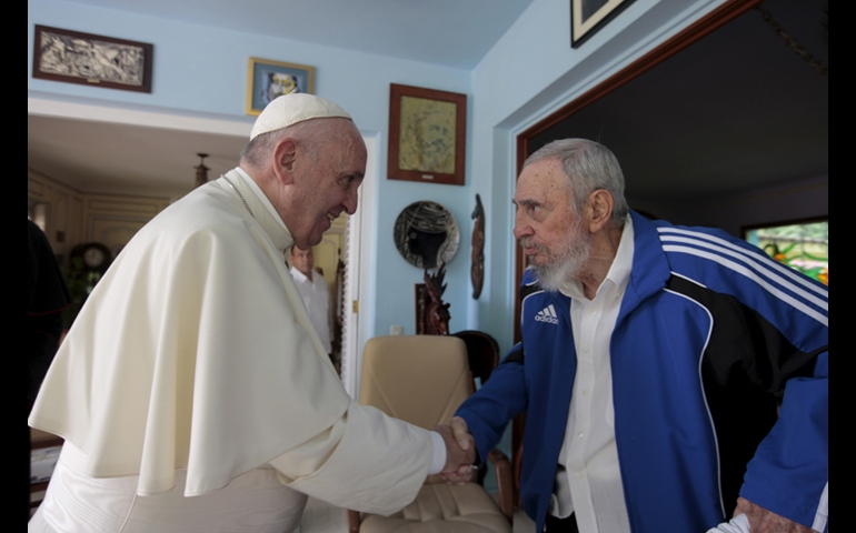 Pope Francis and Cuba's Fidel Castro shakes hands in Havana Cuba Sunday Sept. 20 2015. The Vatican described the 40-minute meeting at Castro's residence as informal and familial with an exchange of books