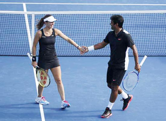 Paes and Hingis win third Slam mixed title of the year