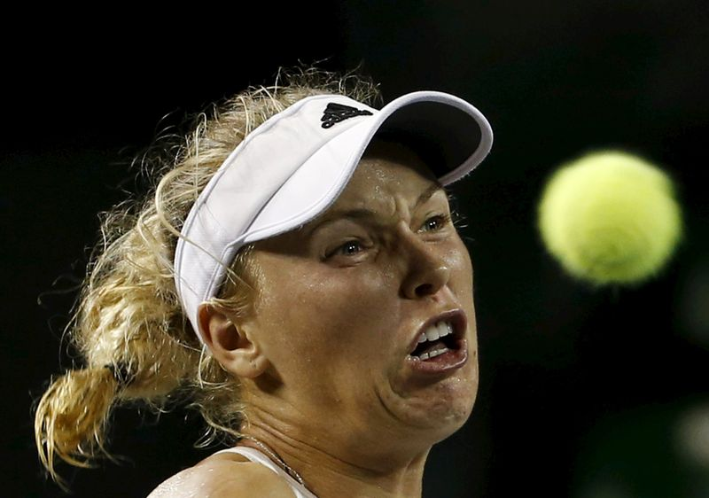 Caroline Wozniacki of Denmark eyes the ball as she returns a shot to Ana Konjuh of Croatia during their Pan Pacific Open women's singles tennis match in Tokyo Japan. – Reuters pic