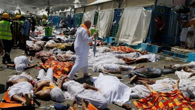 A pilgrim walks among dead bodies after a crush in Mina Saudi Arabia during the Hajj pilgrimage rituals