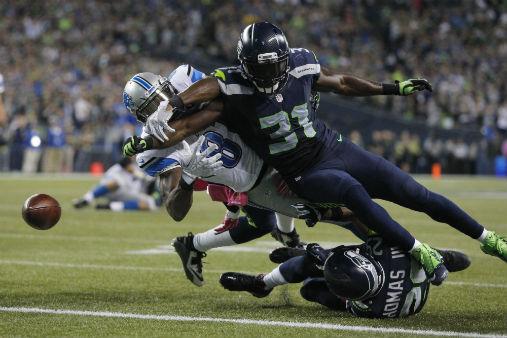 Seattle 13, Detroit 10: Johnson fumbles at goal line