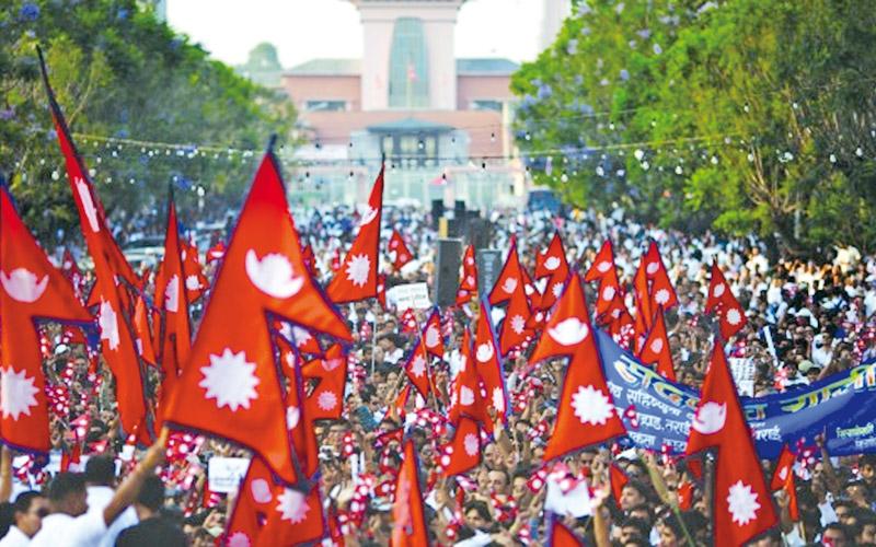 Nepalese waving national flags celebrating in Kathmandu