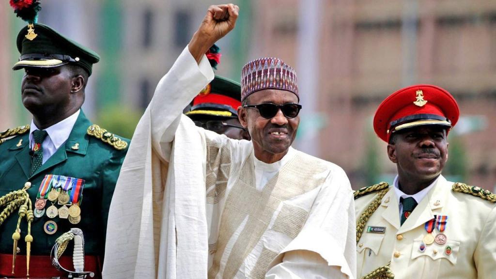 Nigerian President Muhammadu Buhari salutes his supporters during his Inauguration in Abuja Nigeria