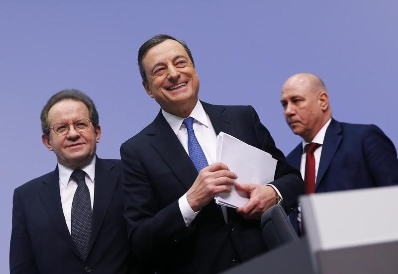 European Central Bank President Mario Draghi and Vice President Vitor Constancio leave after addressing an ECB news conference in Frankfurt