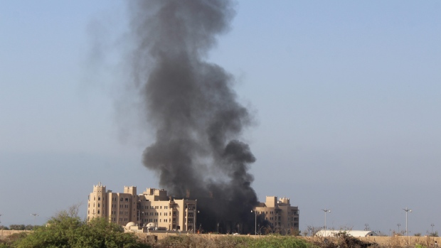 Smoke rises following an explosion Tuesday that hit Hotel al Qasr where Cabinet members and other government officials are staying in the southern port city of Aden Yemen