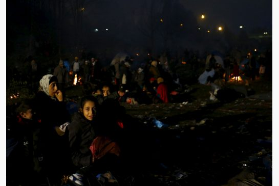 Migrants wait to cross the Austrian border in Spielfeld near the village of Sentilj Slovenia on Sunday. More than 218,000 refugees and other migrants crossed the Mediterranean in October — a record monthly tally this year and more than in the whole