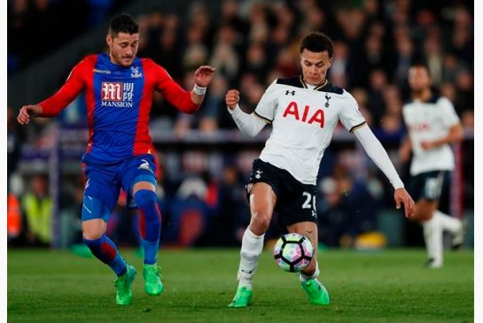Tottenham's Dele Alli right with Crystal Palace's Joel Ward during the English Premier League soccer match between Crystal Palace and Tottenham Hotspur at Selhurst Park stadium in London Wednesday
