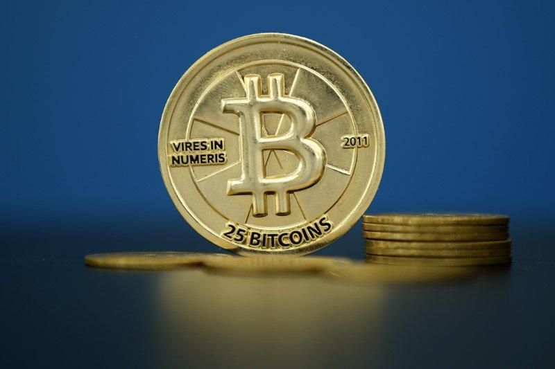 John McAfee challenges Jamie Dimon's bitcoin skepticism