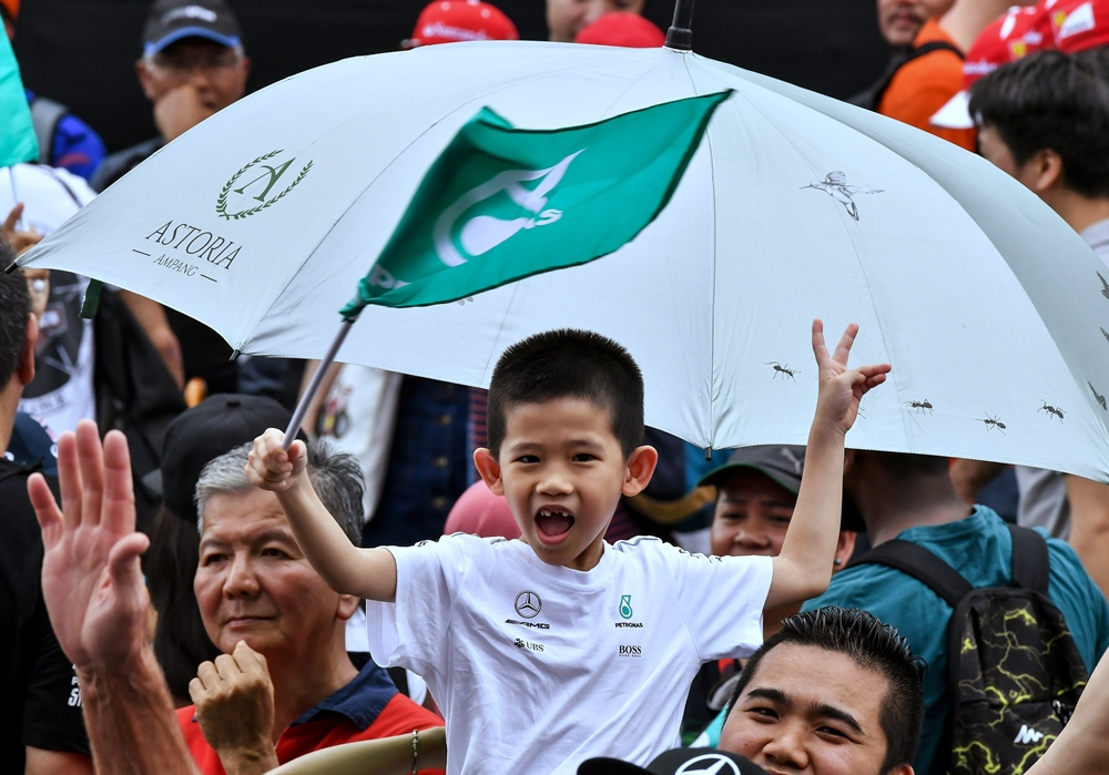 A young F1 fan cheers during the last Malaysian Formula One race at the Sepang International Circuit today. Bernama