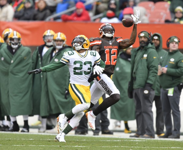 Cleveland Browns wide receiver Josh Gordon reaches for a pass against Green Bay Packers cornerback Damarious Randall during an NFL football game against the Cleveland Browns Sunday Dec. 10 2017 in Cleveland. The Packers won 27-21 in overtime
