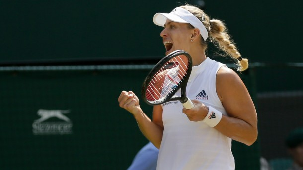 Germany's Angelique Kerber celebrates defeating Latvia's Jelena Ostapenko during their women's singles semi-finals match at the Wimbledon Tennis Championships in London Thursday