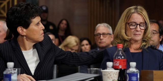 Attorney Debra Katz puts her hand on Christine Blasey Ford as she testifies before the Senate Judiciary Committee